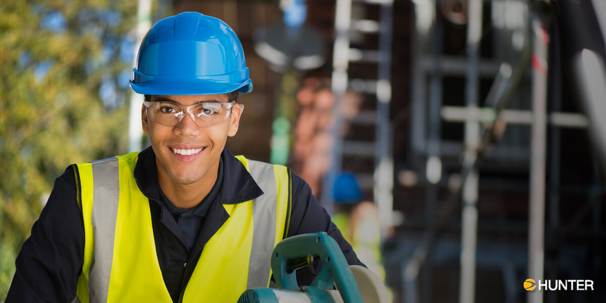 Smiling Contruction Worker in Blue Hardhat