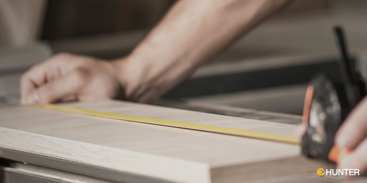 Contractor Using Tape Measurer